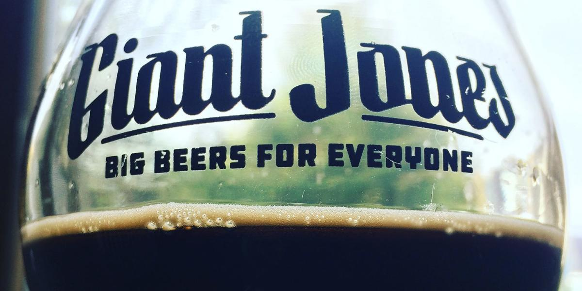 Giant Jones logo on a glass of beer