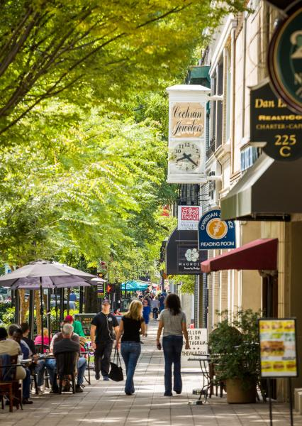 Outdoor dining and shopping on Main Street in downtown Greenville.