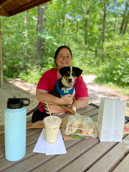 Woman and dog enjoying picnic at Indian Run Falls