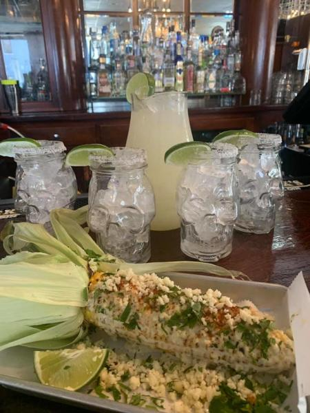 grilled corn at agave and rye in covington ky with pitcher of margaritas in background