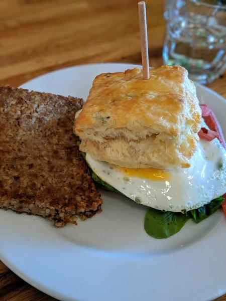 image of goetta and an egg sandwich on a plate served at the baker's table in newport kentucky