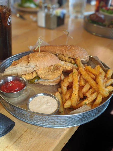 photo of catfish poboy and seasoned fries at the kitchen by butler's pantry in covington ky