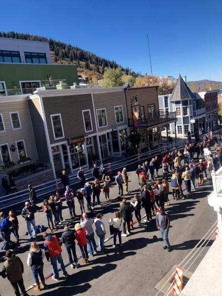 People line up for a shot ski in the road