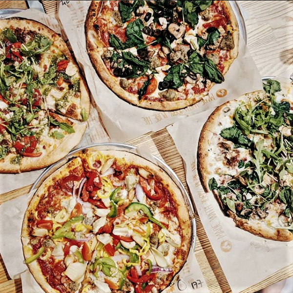 Four different made-to-order pizzas at Blaze Fast Fire'd Pizza.