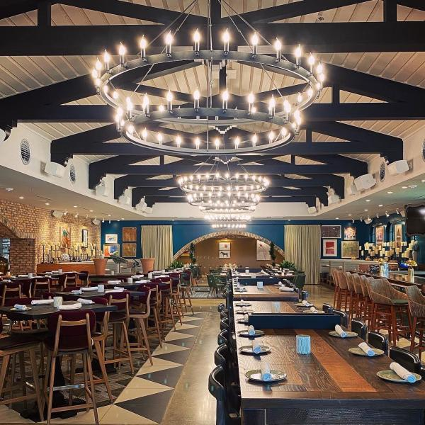 Wood beams and oversized light fixtures give the Mexican Sugar dining area a rustic charm.