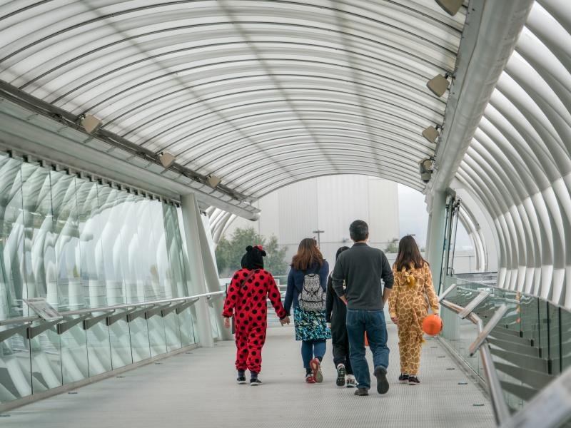 Costumed kids walking in the bridge at the Museum of Flight