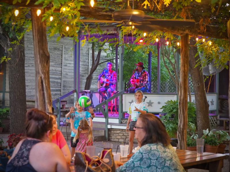 Families enjoying live music at Hondo's on Main outdoor patio