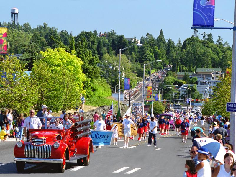 Wide angle view of the Waterland Parade with an old firetruck leading the way
