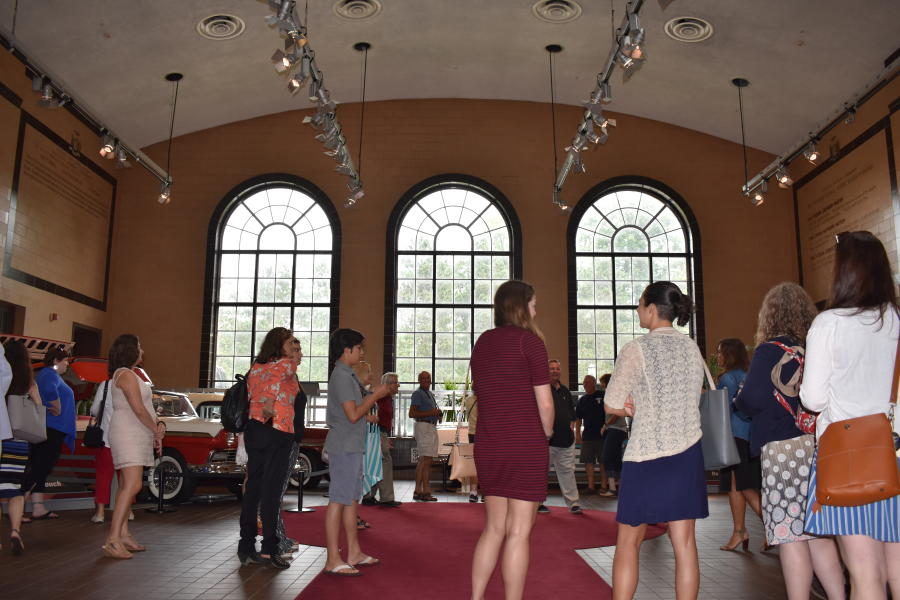 Group getting tour of Saratoga Automobile Museum