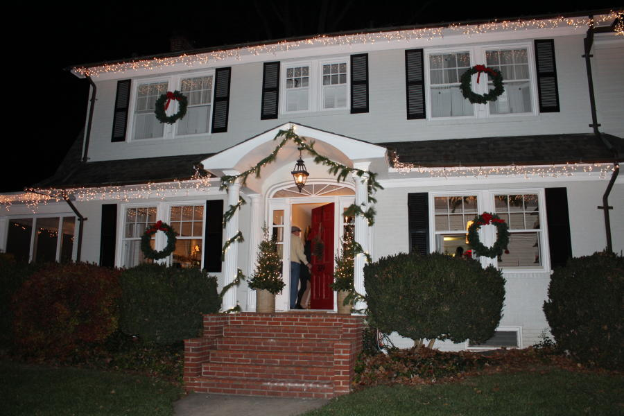 Two-story house with Christmas Lights and Wreath on the Candlelight House Tour