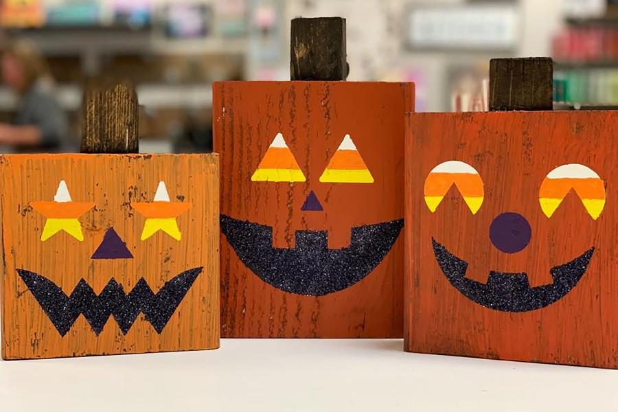 Photo of wood painted like pumpkins from Board and Brush
