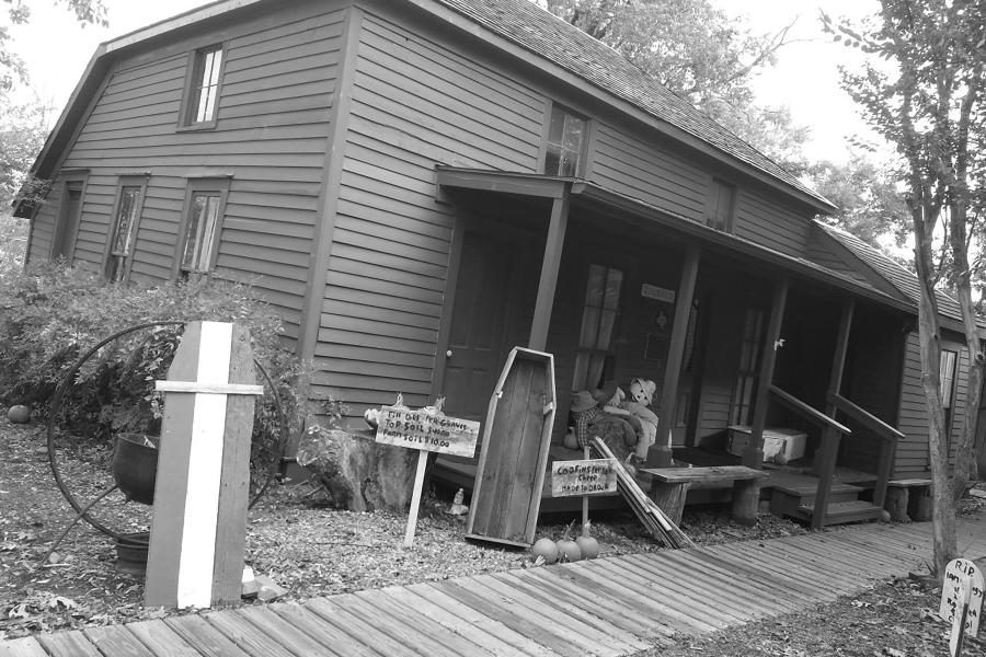 """Black and white photo of exterior of the """"Two Bit"""" Taylor Inn"""