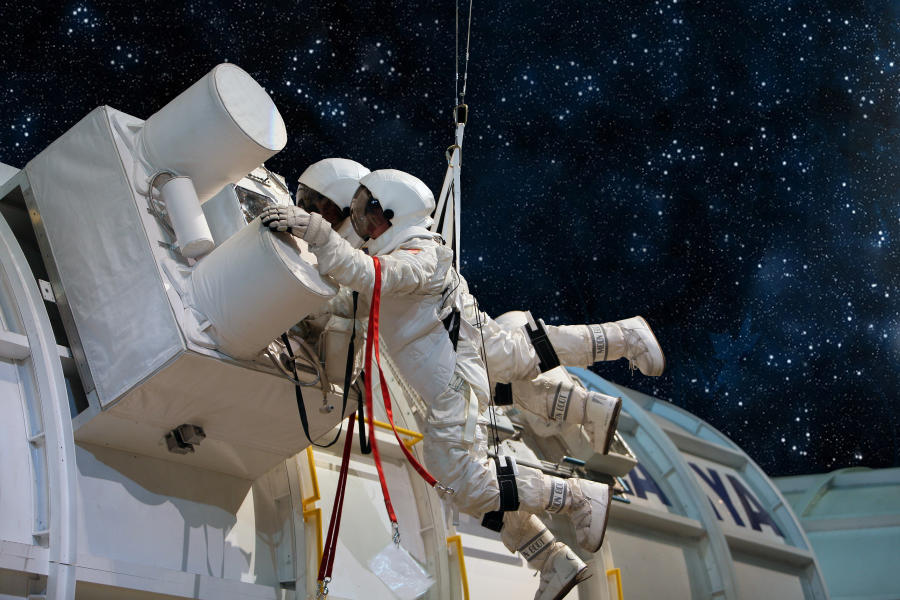 Astronauts Working On A Machine In Space
