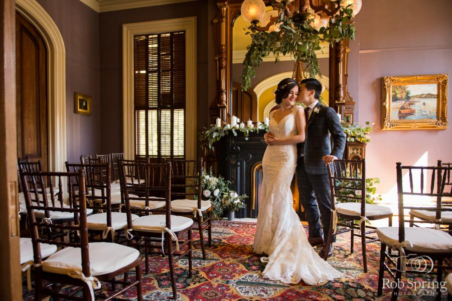 Couple on their wedding day posing inside the Mansion Inn