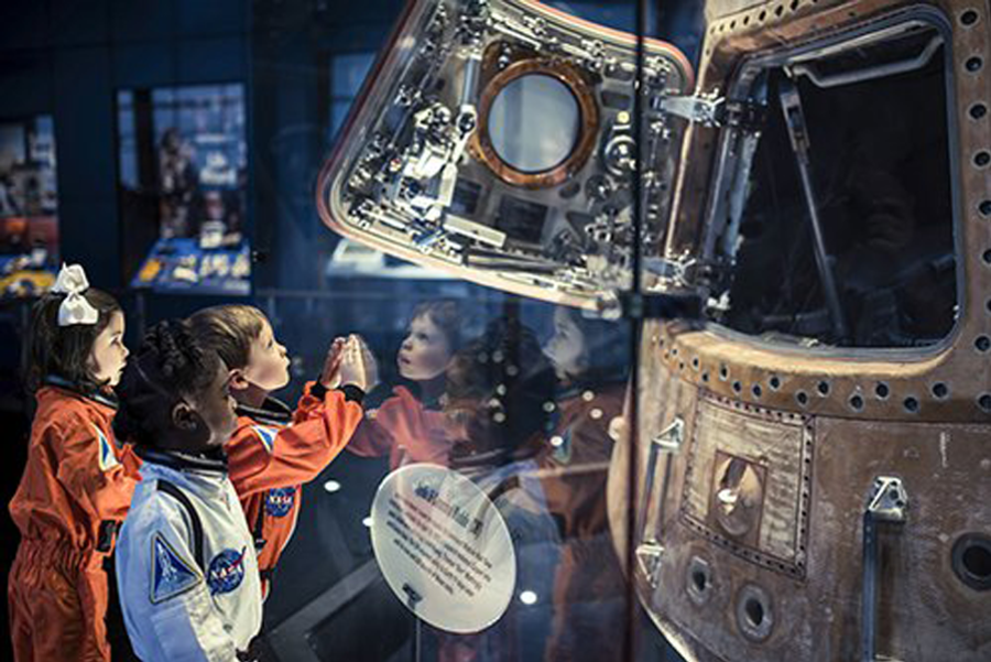 Children look on in awe at the Apollo 16 Command Module at the U.S. Space & Rocket Center.