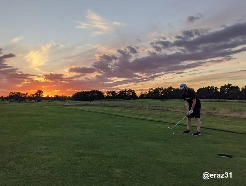 Sunset over golfer at Lake Forest Golf Club