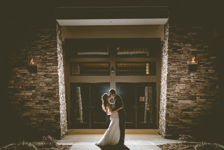 Embrace at entrance by  Wallflower Photography