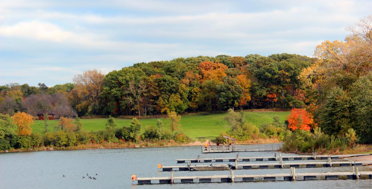 Piers at lake with fall color background