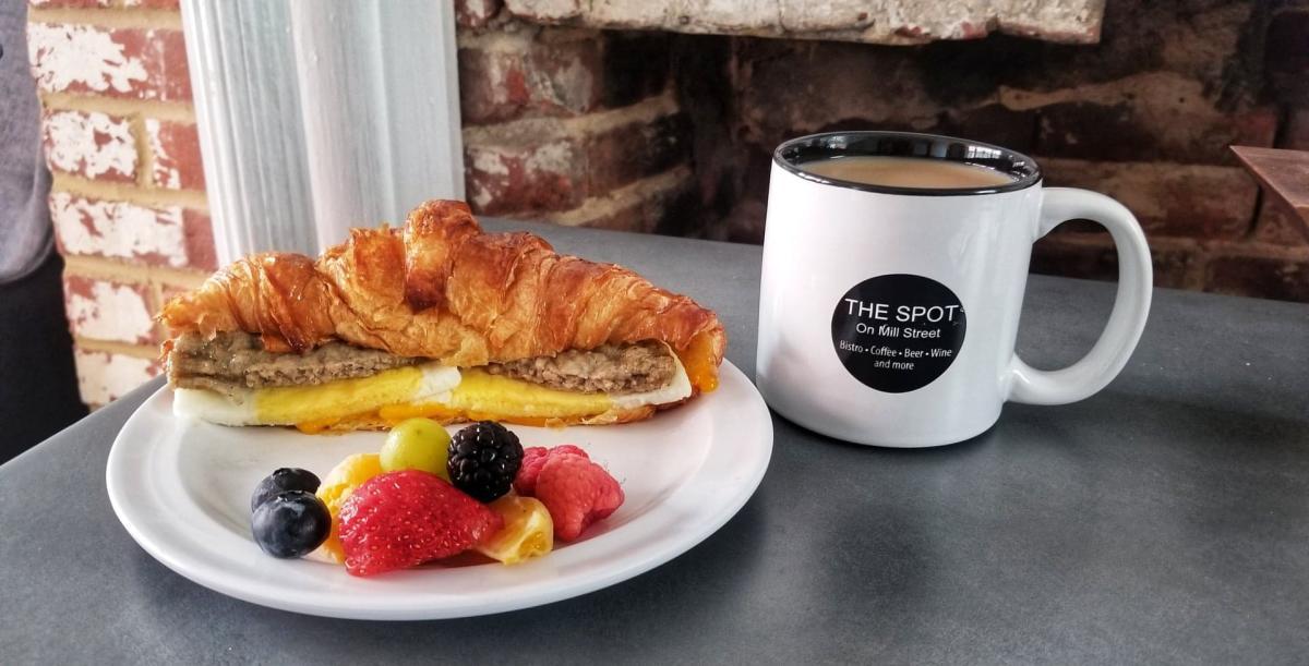 The Spot on Mill Street Breakfast Sandwich, fruit and coffee
