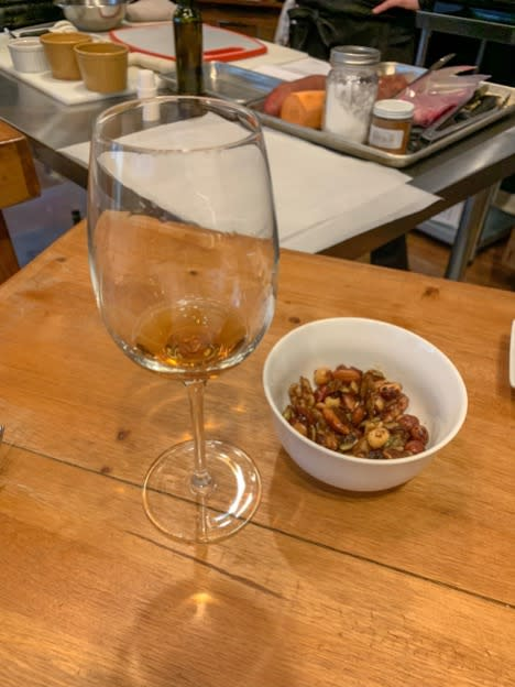 Glass of wine and bowl of nuts