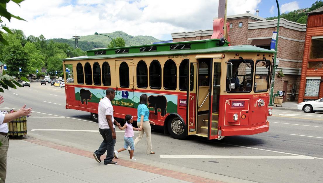 People Walking Toward Trolley