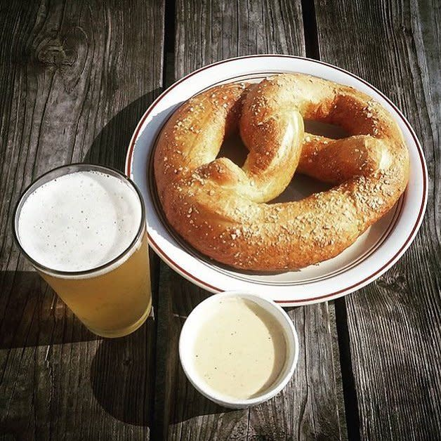A huge german pretzel and beer cheese and beer at Wunderbar in Covington, KY