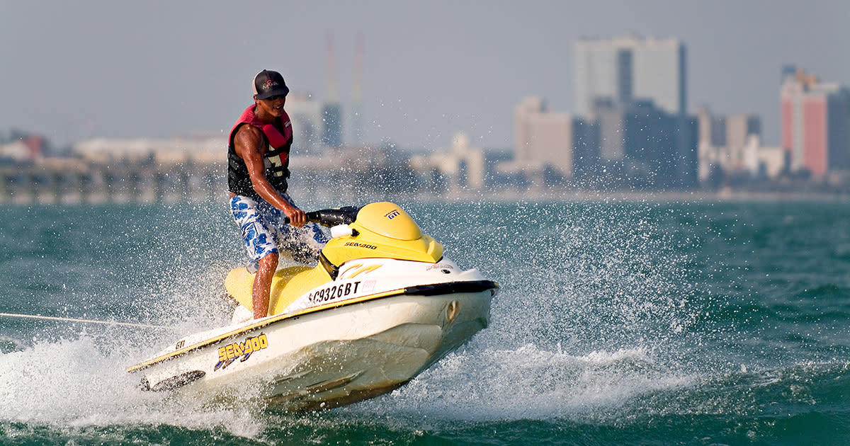 Guy jet skiing along the coast of Myrtle Beach
