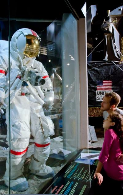A father and daughter looking at a spacesuit at the Cosmosphere in Hutchinson