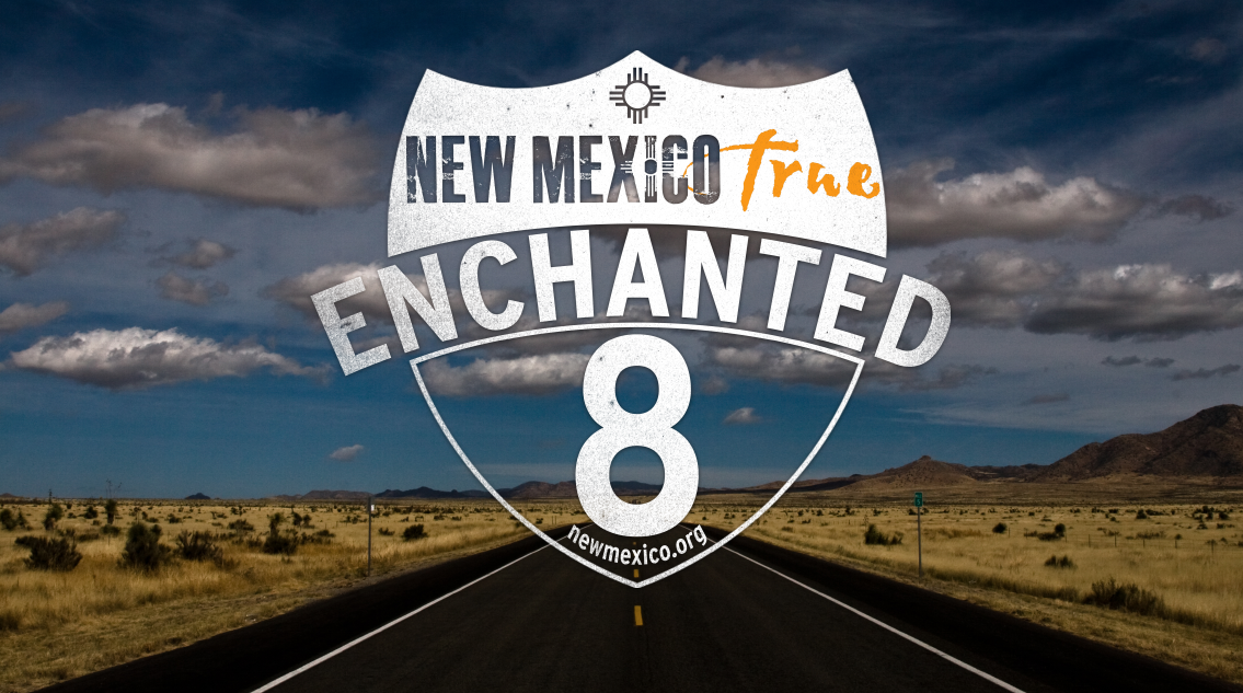 An image of an open rural highway with a text overlay reading: New Mexico Enchanted 8.