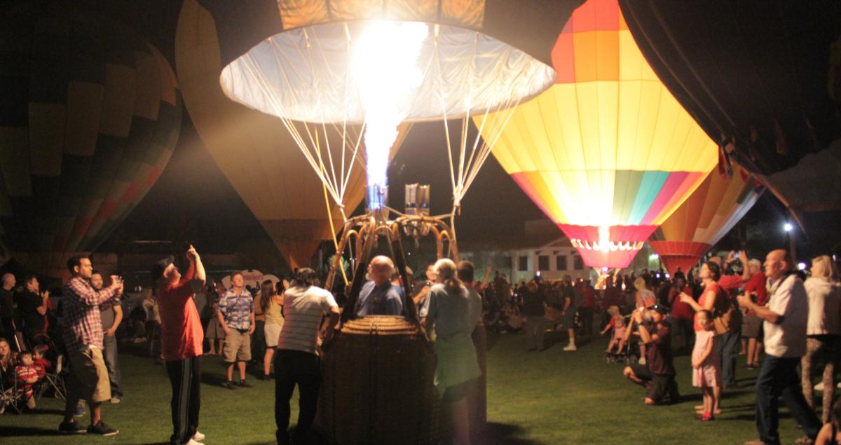 Hot Air Balloons attracting a crowd during the nighttime