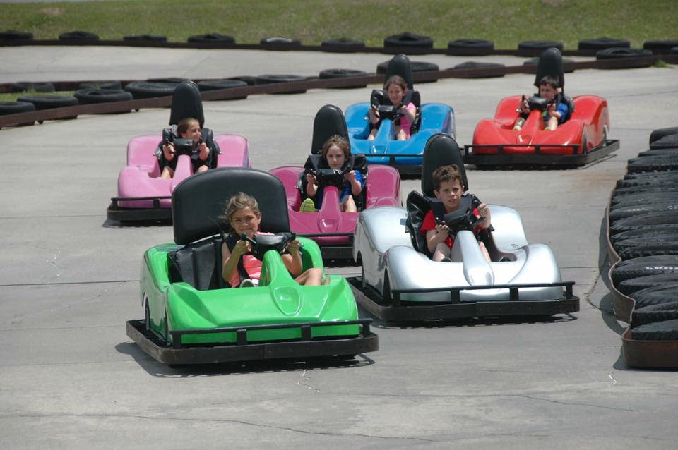 Kids go-karting at Kart Ranch in different colored karts