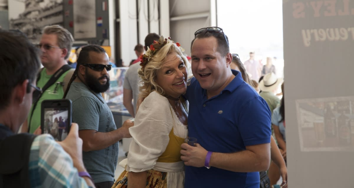 Couple posing for a photo at Props & Hops Craft Beer Festival