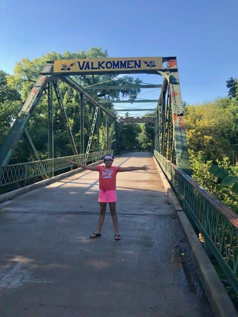 Girl Standing on Valkommen Trail Bridge in Kansas