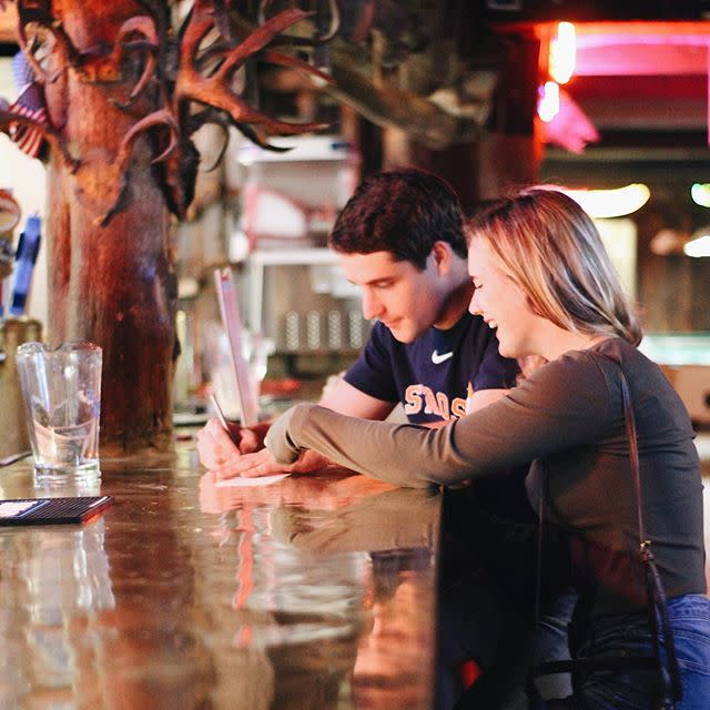 Northgate Couple Paying At Bar
