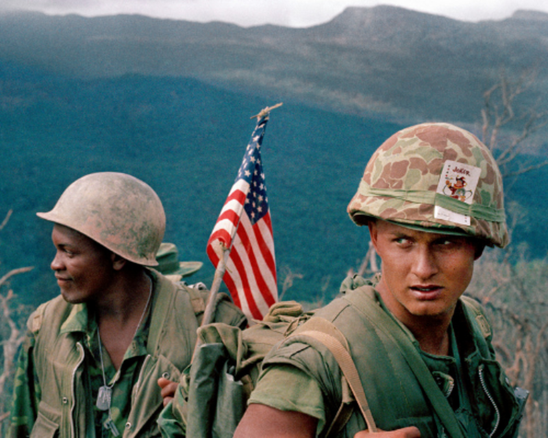 U.S. Marines move through a landing zone, December 1969. (©AP Photo).