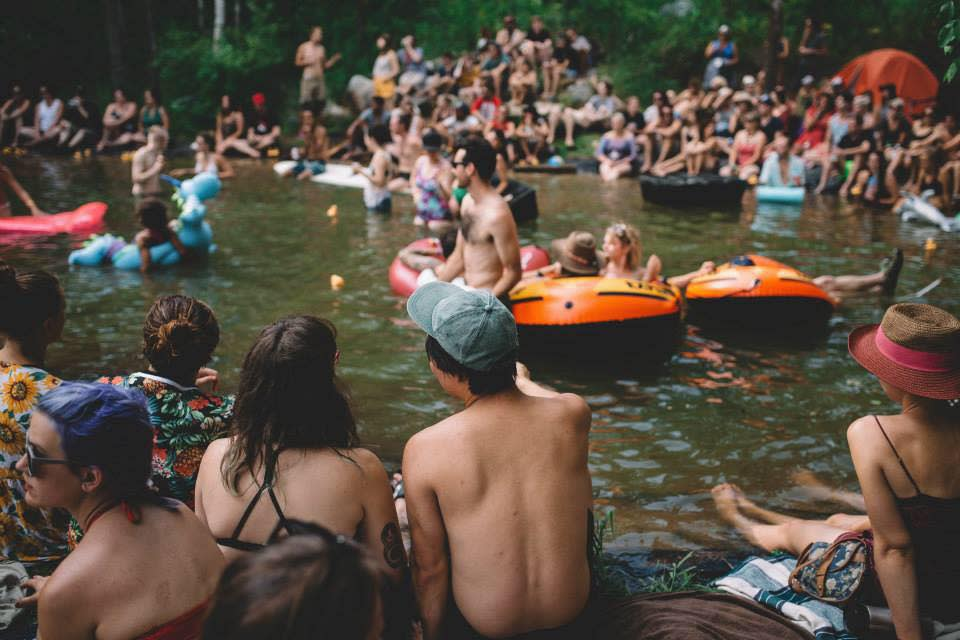 Crowds staying cool in the water at the Rainbow Trout Festival