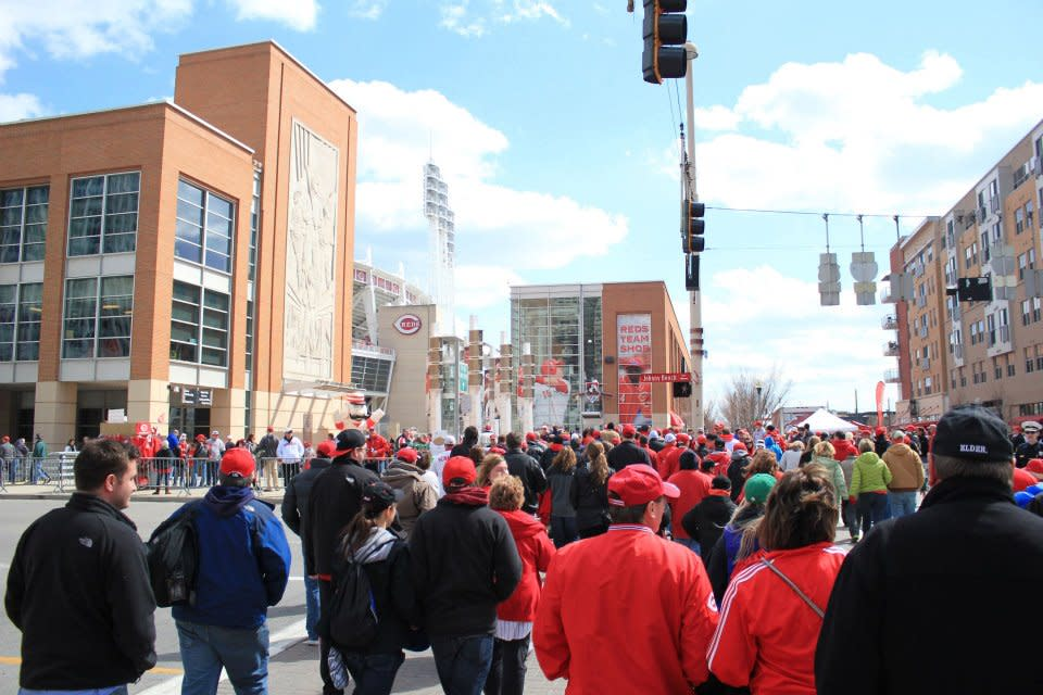 A crowd of Cincinnati Reds fans in the Opening Day parade, heading into the Great American Ballpark