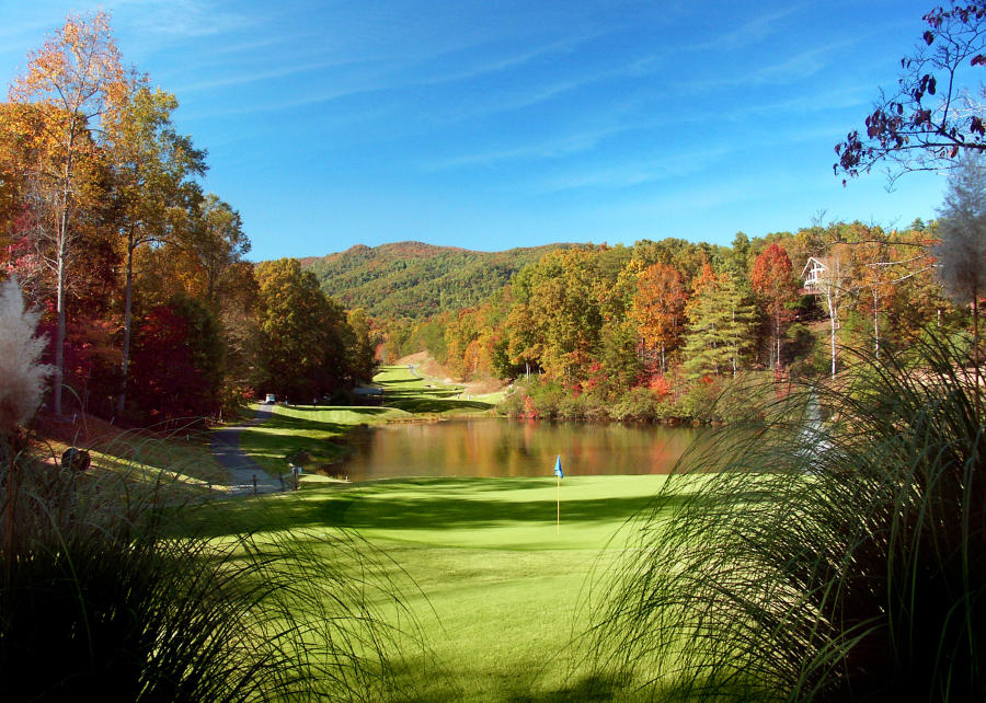Fall color backdrop at Rumbling Bald Golf Course