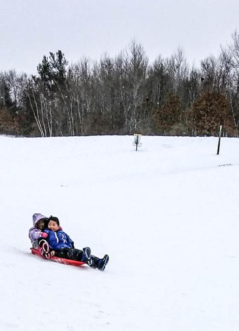 2 kids on sled