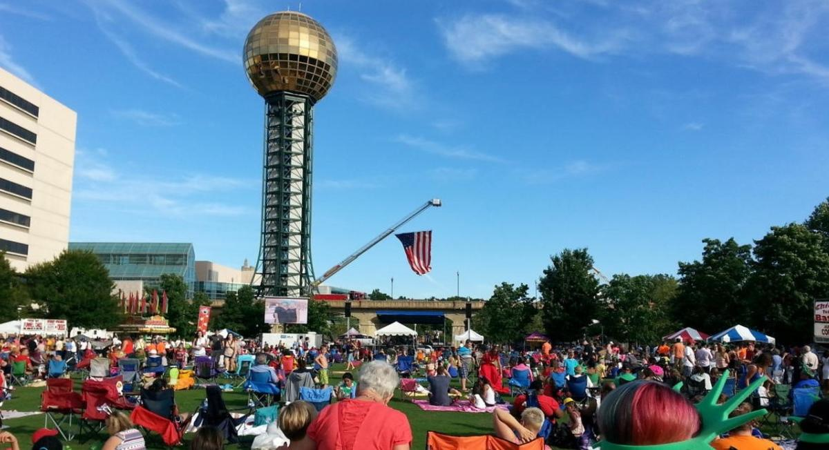 Crowd at the World's Fair Park sitting on blankets and chairs for the Festival on the 4th