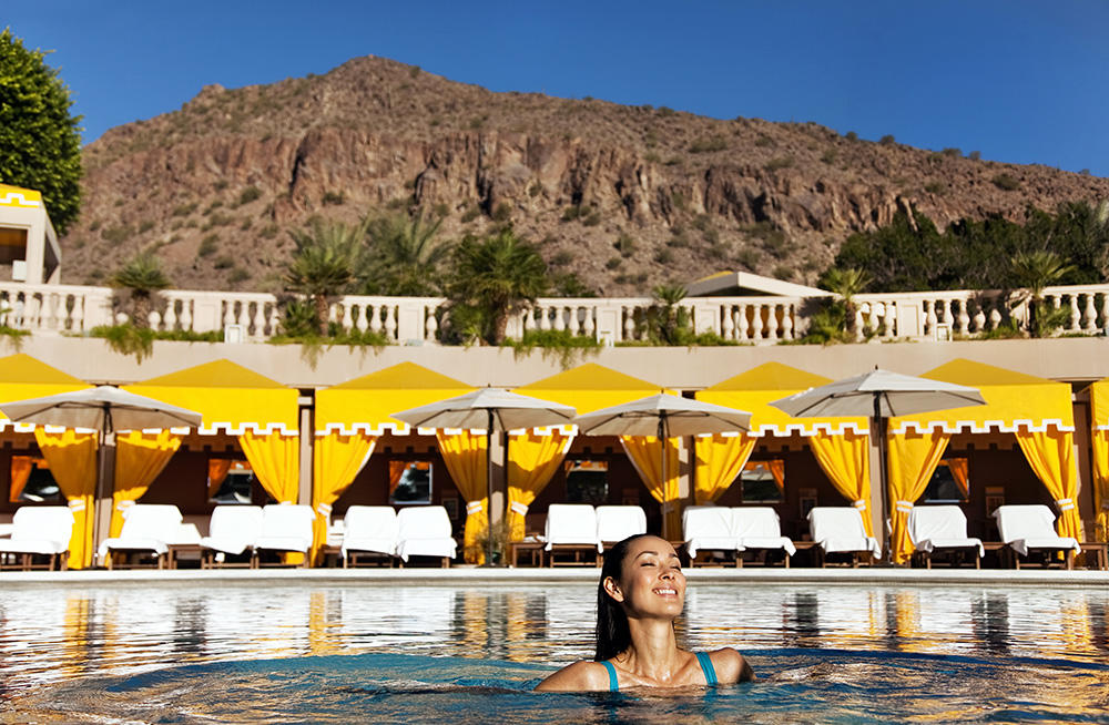 Phoenix's The Phoenician is an iconic resort nestled at the base of Camelback Mountain and features breathtaking views, 18-hole golf course, award-winning three-story spa, fine dining, a poos, splash park, and waterslides.