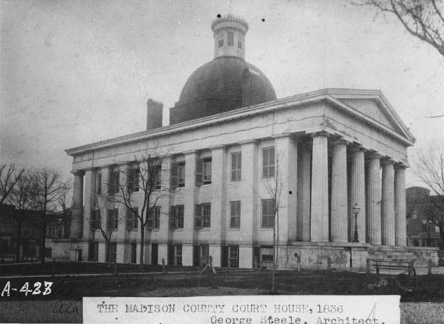 A black-and-white photograph of the Madison County Courthouse taken in 1836.
