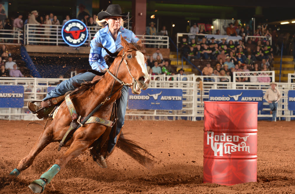 Woman competing in the barrel racing event at Rodeo Austin