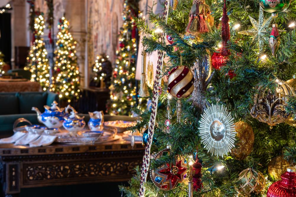 Gorgeous ornaments decorate the trees in the Tapestry Gallery during Christmas at Biltmore