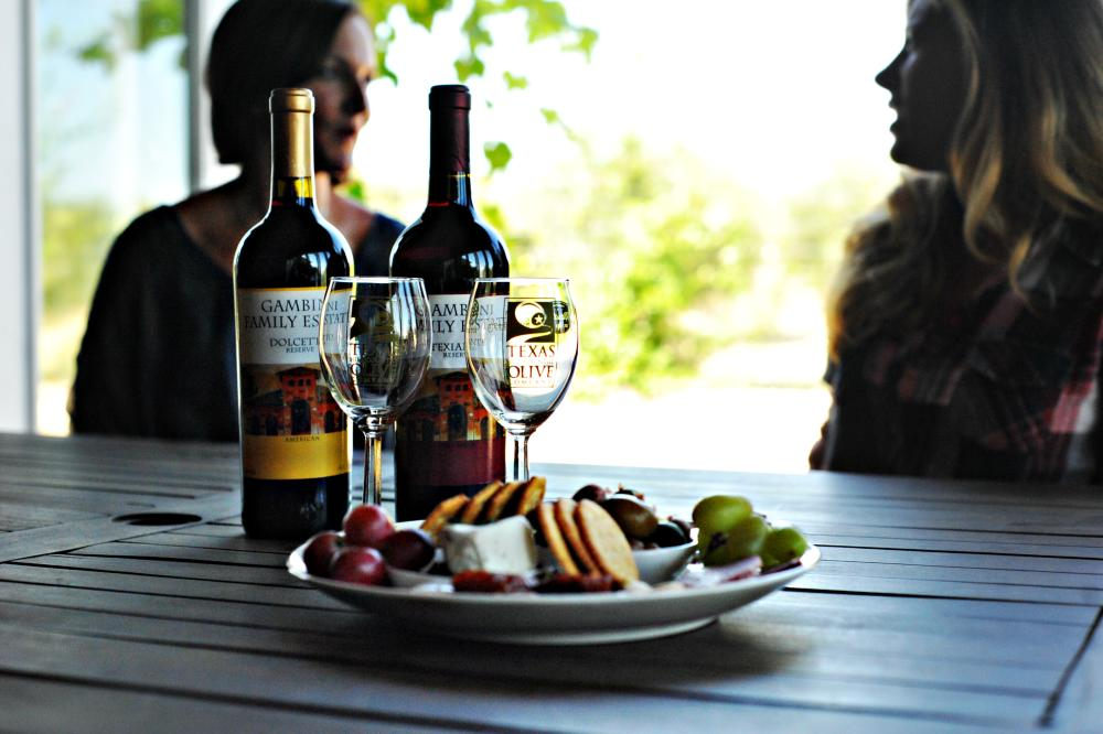 snack plate and wine at the Texas Hill Country Olive Company in Dripping Springs near Austin