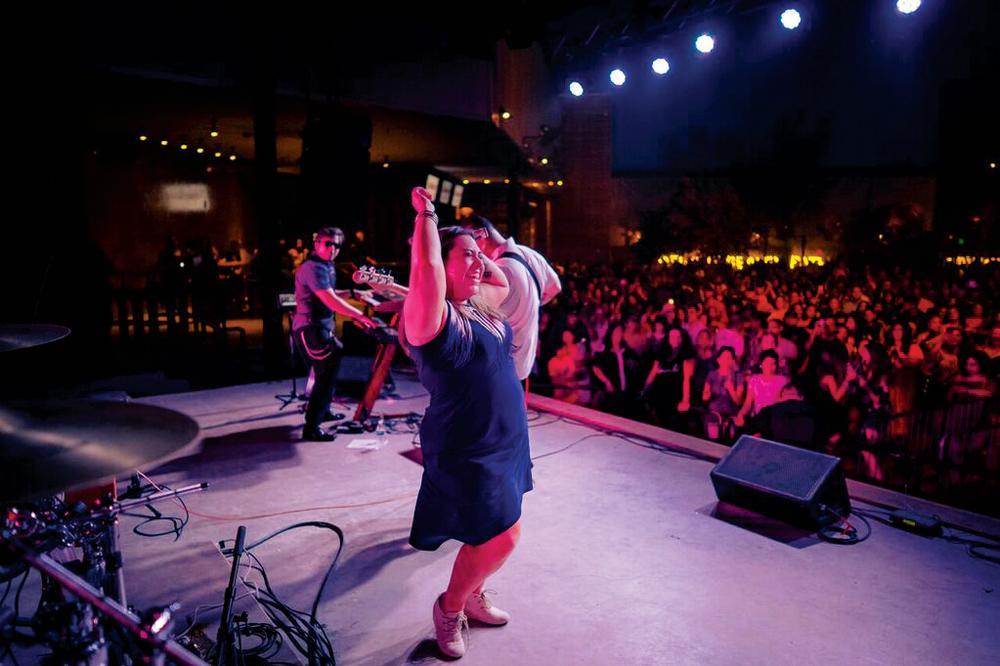 Stephanie Bergara with Bidi Bidi Banda selena cover band performing in austin texas