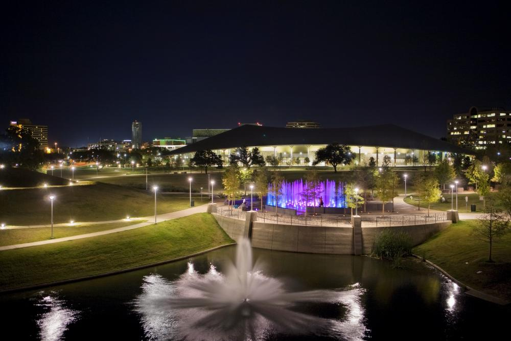 Palmer Event Center and fountains at night