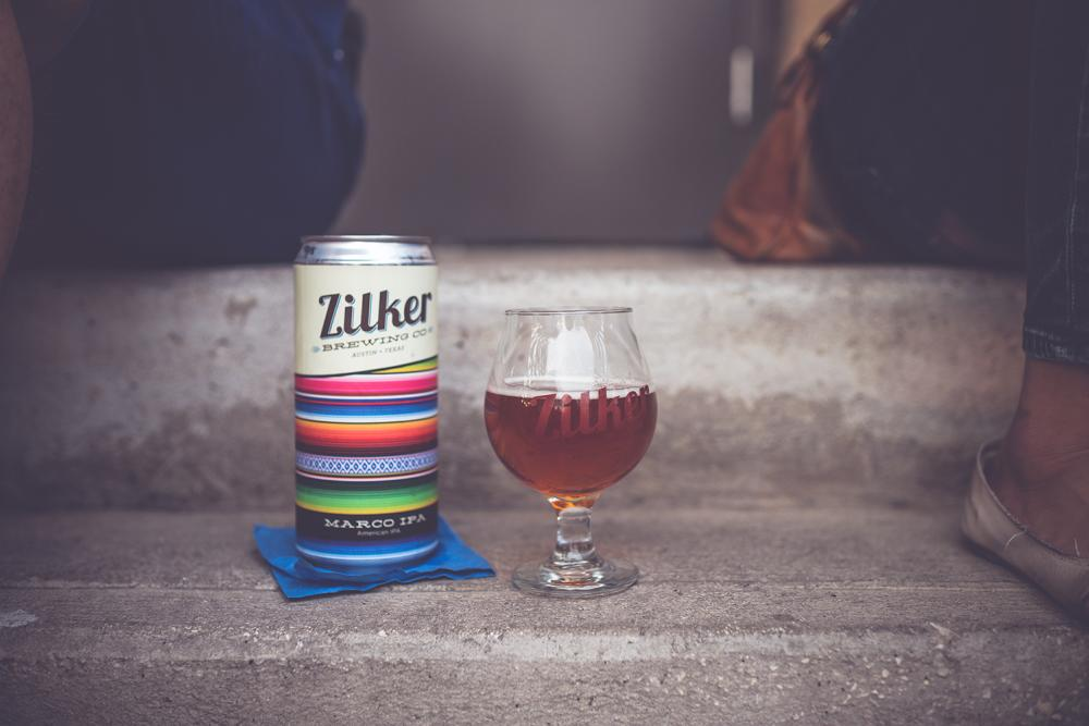 Tulip glass and can of Zilker IPA