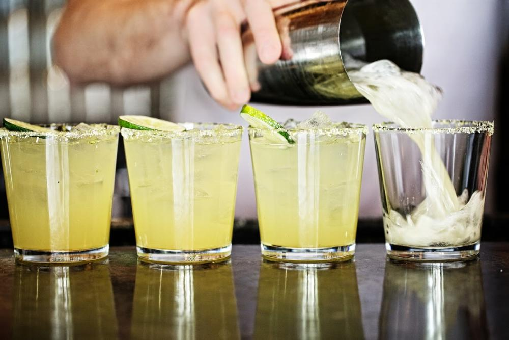 Bar tender pouring margaritas at La Condesa