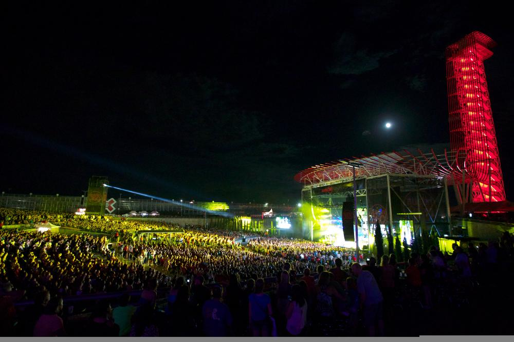 Austin 360 Amphitheater with band on stage at Night